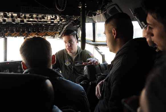 "Tech. Sgt. Nicholas Brandt, C-130 Hercules loadmaster assigned to the 731st Airlift Squadron, briefs trainees about C-130 Hercules aircraft capabilities Apr. 2, 2017, at Peterson Air Force Base, Colo. The trainees are in the 302nd Airlift Wing and 310th Space Wing Development and Training Flight. The purpose of D&TF is to prepare trainees for basic training, technical school, and an Air Force Reserve career. ""The goal is to get our trainees on a C-130 Hercules tour every four months,"" said Tech. Sgt. Jemario Patterson, 302nd AW D&TF program coordinator. ""We tour other 302nd AW squadrons so trainees can learn the mission of each unit and see reservists in action."" (U.S. Air Force photo/Staff Sgt. Amber Sorsek)"