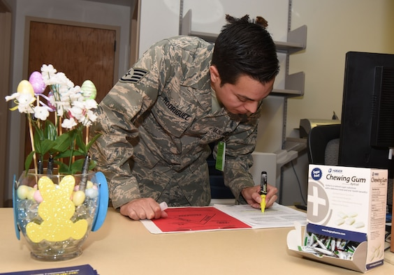Staff Sgt. Richard Rodriguez, 90th Medical Operations Squadron dental support NCO in charge, checks Personnel Reliability Assurance Program paperwork at F.E. Warren Air Force Base, Wyo., April 6, 2017. The dental clinic plays a key role in ensuring that Airmen are fit to support the nuclear deterrence mission. (U.S. Air Force photo by Airman 1st Class Breanna Carter)
