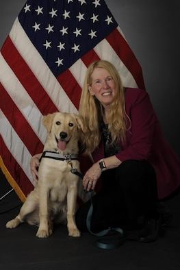 U.S. Air Force civilian Shellie Severa, the 354th Fighter Wing Sexual Assault Prevention and Response (SAPR) head victim advocate, poses with Tessa, the first SAPR K-9, April 6, 2017, at Eielson Air Force Base, Alaska. Severa is a certified K-9 trainer, serves as Tessa's primary handler and has been working as a victim advocate for 9 years. (U.S. Air Force photo by Staff Sgt. Ashley Nicole Taylor)