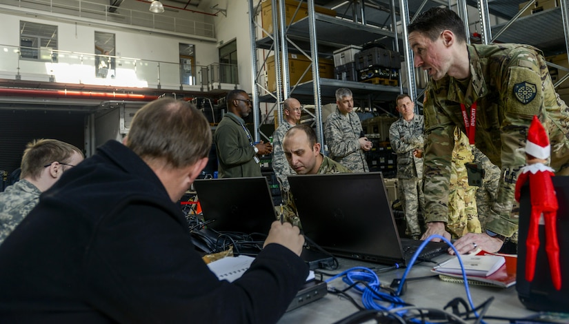 U.S. Army Staff Sgt. Matthew Malesinski, right, 201st Cyber Protection Team network security analyst, talks with his team during a cyber security audit of the 1st Combat Communications Squadron's tactical communications kits March 16, 2017, on Ramstein Air Base, Germany. The 1st CBCS requested the 201st CPT, which is part of the U.S. Army Cyber Protection Brigade, to test both the physical and internal security of their systems that allow them to set up and manage secure communications at deployed locations. (U.S. Air Force photo/Staff Sgt. Timothy Moore)