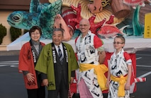 Mrs. Teiko Taneichi, left, wife of Kazumasa Taneichi, center left, Misawa City mayor, pause for a photo with Col. R. Scott Jobe, center right, 35th Fighter Wing commander, and his son, Chet Jobe, during the 30th Annual Japan Day at Misawa Air Base, Japan, April 7, 2017. For the first time the base event featured one of the many floats from Aomori City's larger Nebuta festival parade, which occurs every summer. (U.S. Air Force photo by Airman 1st Class Sadie Colbert)
