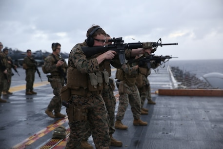 U.S. Marines with Combat Logistics Battalion (CLB) 31, 31st Marine Expeditionary Unit (MEU) conduct marksmanship training during a deck shoot aboard the USS Bonhomme Richard (LHD 6), in the Pacific Ocean, March 14, 2017. Marines with CLB-31, 31st MEU underwent combat marksmanship training as a part of the 31st MEU's 17.1 Spring Patrol of the Asia-Pacific region. As the Marine Corps' only continuously forward deployed unit, the 31st MEU's air-ground-logistics team provides a flexible force, ready to perform a wide range of military operations, from limited combat to humanitarian assistance operations, throughout the Asia-Pacific region. (U.S. Marine Corps photo by Sgt. Tiffany Edwards)