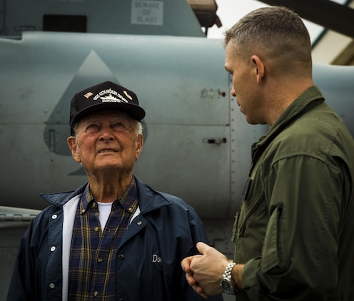 Lt. Col. Bryan G. Swenson gives Donald Irwin, a United States Navy World War II veteran, a tour of the MV-22 Osprey, April 7, 2017 on Marine Corps Air Station Futenma, Okinawa, Japan. Irwin took part in battles for Midway, Guadalcanal, and survived the sinking of the USS Colhoun during the battle for Okinawa. Irwin decided to return to Okinawa and exchange stories with the Marines and Sailors stationed on the island. Swenson, a Kansas City, Missouri, native, is the commanding officer of Marine Medium Tiltrotor Squadron 265, Marine Aircraft Group 36, 1st Marine Air Wing, III Marine Expeditionary Force. Irwin is a native of San Jose, California. (U.S. Marine Corps photo by Lance Cpl. Joshua Pinkney)
