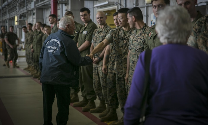 Don Irwin, a U.S. Navy veteran of World War II, shakes Lance Cpl. Hui Xue's hand April 7, 2017 on Marine Corps Air Station Futenma, Okinawa, Japan. Irwin, who served aboard a number of ships during World War II, took part in battles for Midway and Guadalcanal and survived the sinking of the USS Calhoun during the battle for Okinawa. Irwin returned to Okinawa and exchanged stories with the Marines and Sailors stationed on the island. Irwin is a San Jose, California native and Xue, a New York, New York, native, is an aviation life support system technician with Marine Medium Tiltrotor Squadron 265, Marine Aircraft Group 36, 1st Marine Air Wing, III Marine Expeditionary Force. (U.S. Marine Corps photo by Cpl. Amaia Unanue)