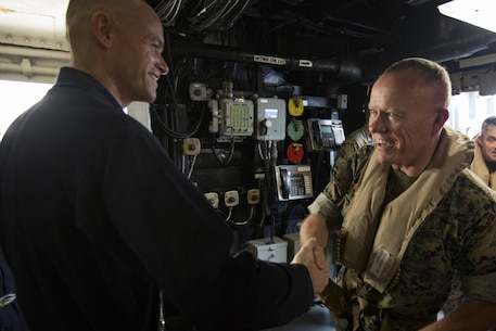 U.S. Marine Lt. Gen. Lawrence D. Nicholson, commanding general of III Marine Expeditionary Force, is greeted by U.S. Navy Capt. Nathan Moyer, commanding officer of the USS Green Bay (LPD 20), underway in the Pacific Ocean, March 21, 2017. Nicholson spoke with Marines and Sailors of the 31st Marine Expeditionary Unit, a III MEF component currently aboard ships of the Bonhomme Richard Amphibious Ready Group. As the Marine Corps' only continuously forward-deployed unit, the 31st MEU air-ground-logistics team provides a flexible force, ready to perform a wide range of military operations, from limited combat to humanitarian assistance operations, throughout the Indo-Asia Pacific region. (U.S. Marine Corps photo by Cpl. Darien J. Bjorndal)