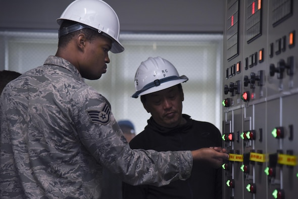 Staff Sgt. Quintin Robinson, 374th Civil Engineer Squadron electrical shop exterior NCO in charge, turns off a substation circuit breaker before repairing a high-voltage transformer in the West Substation at Yokota Air Base, Japan, April 8, 2017. In order to repair a high-voltage transformer, power needed to be down for about 19 hours and it affected certain parts of the main and west side of the base. (U.S. Air Force photo by Machiko Arita)