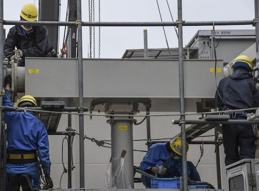 Contractors from Fuji Electric System Company, Limited work to remove a busbar on the gas-insulated high-voltage switchgear from which gas leaked at Yokota Air Base, Japan, April 8, 2017.The 374th Civil Engineer Squadron along with the contractors repaired the gas leak from one of the gas-insulated high-voltage switchgear in the West Substation to prevent further damage. (U.S. Air Force photo by Machiko Arita)