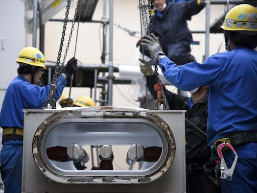 Contractors from Fuji Electric System Company, Limited take a busbar down at Yokota Air Base, Japan, April 8, 2017. During the power outage, the 374th Civil Engineer Squadron and contractors de-energized the transformers, removed the remaining gas from the busbar on the gas-insulated high-voltage switchgear, deconstructed the busbar, repaired a rusty flange and replaced a gasket of the busbar. (U.S. Air Force photo by Machiko Arita)