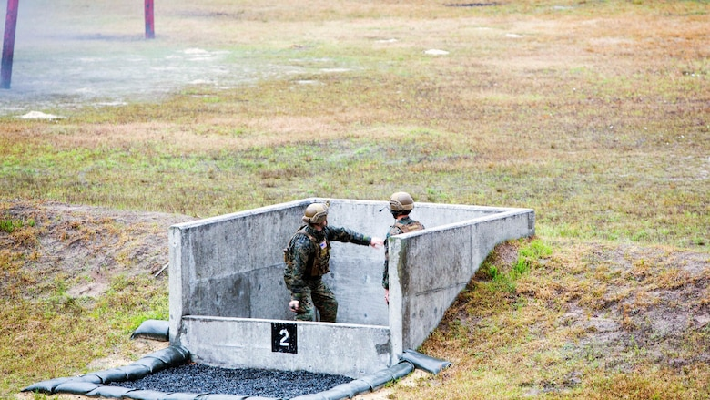 A Marine throws an M67 fragmentation grenade during a grenade range at Marine Corps Base Camp Lejeune, N.C., March 31, 2017. The training helped Marines build trust and confidence in each other by refining the skills needed to operate in a combat environment. The Marines are with 2nd Reconnaissance Battalion.