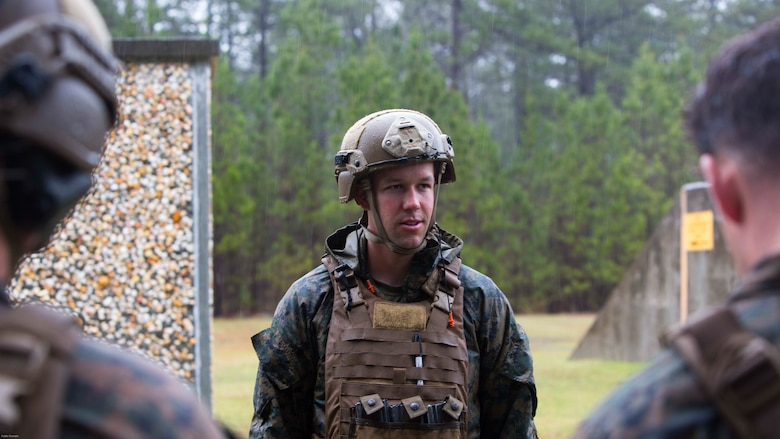 Capt. Aaron D. Foote briefs the Marines after a grenade range at Marine Corps Base Camp Lejeune, N.C., March 31, 2017. The training built Marines' confidence in employing the M67 fragmentation grenade pre-deployment package to starting their workup for the 26th Marine Expeditionary Unit. Foote is a platoon commander with 2nd Reconnaissance Battalion.