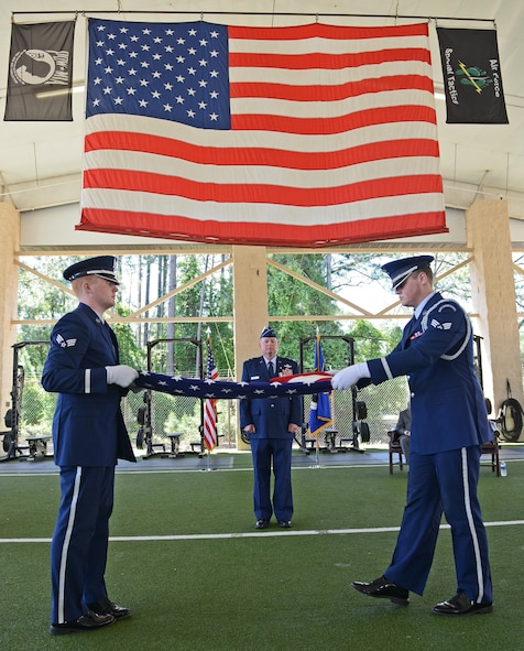 Maj. Gen. Eugene Haase, vice commander of Air Force Special Operations Command, watches two honor guardsmen fold his flag during his retirement ceremony at Hurlburt Field, Fla., April 10, 2017. Haase's parents had the flag flown over Washington D.C. for him, and presented it to him when he graduated flight training in 1984. (U.S. Air Force photo/Staff Sgt. Melanie Holochwost)