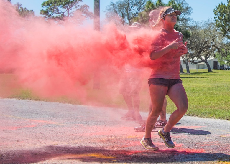 A runner leaves a pink powder trail as she moves toward the finish line during the 4th annual Color Me Aware Fun Run April 6 near the Civil Engineer Pavilion at Eglin Air Force Base, Fla. The run is held to raise sexual assault awareness. (U.S. Air Force photo/Ilka Cole)