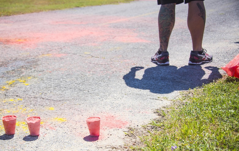 Cups of colored power sit on the pavement ready to be tossed on run participants during the 4th annual Color Me Aware Fun Run April 6 near the Civil Engineer Pavilion at Eglin Air Force Base, Fla. The run is held to raise sexual assault awareness. (U.S. Air Force photo/Ilka Cole)