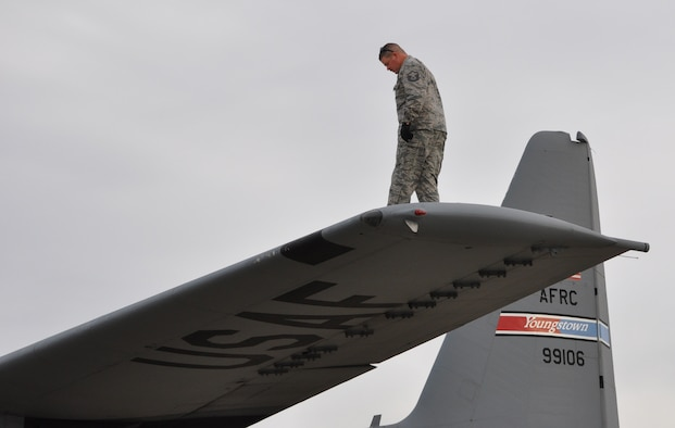 Master Sgt. Dan Scott, 910th Aircraft Maintenance Squadron Dedicated Crew Chief (DDC), performs the upper wing portion of a preflight inspection on a C-130H Hercules aircraft here, April 3, 2017. Preflight inspections help ensure safety for the aircrew and aircraft. Scott is the DDC on this aircraft. (U.S. Air Force photo/Maj. Polly Orcutt)