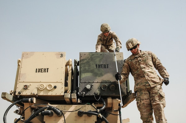 Soldiers of Battery D, 4th BN, 5th Air Defense Artillery Regiment, demonstrate reloading a Patriot missile battery for Soldiers of Task Force Spartan at a Patriot Missile site on Camp Buerhing, Kuwait April 8, 2017. Task Force Spartan personnel visited the site to obtain an on-the-ground assessment of the operational needs of Patriot Missile sites within the Task Force Spartan area of responsibility. (U.S. Army Photo by Master Sergeant Sean McCollum, 29th Infantry Division Public Affairs)