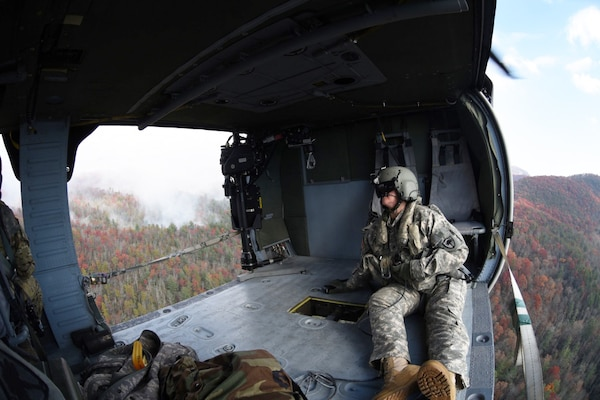 Army Staff Sgt. Jessica Thibeau, with the South Carolina Army National Guard's 59th Aviation Troop Command, observes from a UH-60 Black Hawk helicopter during efforts to fight South Carolina wildfires, Nov. 24, 2016. South Carolina Army National Guard photo by Staff Sgt. Roberto Di Giovine