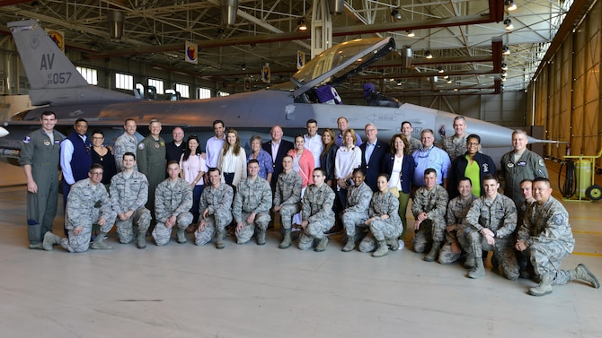 Nine state representatives meet with 31st Fighter Wing Airmen during their visit to Aviano Air Base, Italy, April 8, 2017. The wing Airmen met their representative to inform them on how they impact the overall mission. (U.S. Air Force photo by Senior Airman Cary Smith)