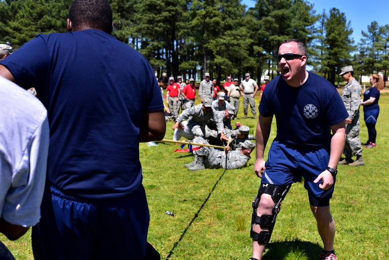U.S. Air Force Master Sgt. Paul Evans, 19th Security Forces Logistics superintendent, motivates his Defenders in a tug of war contest April 7, 2017 during the Mission Support Group Warrior Ethos Challenge at the track on Little Rock Air Force Base, Ark. The Warrior Ethos Challenge runs through multiple events of strength, endurance, resilence and teamwork and has been an annual MSG event for five years.   