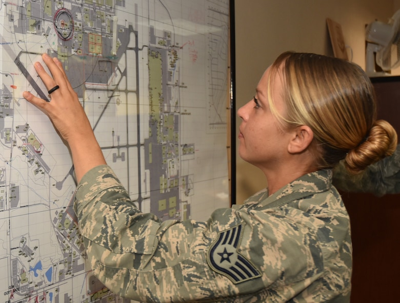 Staff Sgt. Lara, 552nd Air Control Wing Command Post Controller, plots an incident location during a recent exercise.  Sergeant Lara was recently named the Air Combat Command's Command Post Non-Commissioned Officer for 2016. (Air Force photo by Ron Mullan)