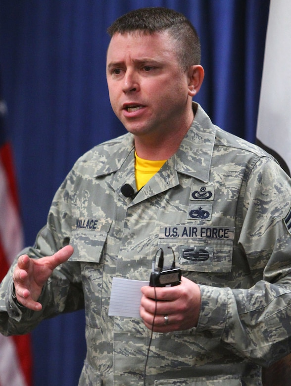 Senior Master Sgt. Kevin Wallace of the 89th Airlift Wing at Joint Base Andrews, Maryland, speaks to enlisted Airmen about resiliency and shares his personal narrative during an enlisted all-call held for the 163d Attack Wing on Aug. 6, 2016, at March Air Reserve Base, California. (Air National Guard Photo by Airman 1st Class Crystal Housman)