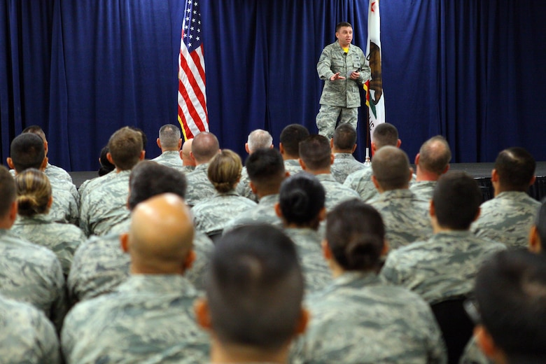 Senior Master Sgt. Kevin Wallace of the 89th Airlift Wing at Joint Base Andrews, Maryland, speaks to enlisted Airmen about resiliency and shares his personal narrative during an enlisted all-call held by the 163d Attack Wing on August 6, 2016, at March Air Reserve Base, California. (Air National Guard Photo by Airman 1st Class Crystal Housman)