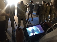 """A camera crew films Security Forces Instructors and trainees from the 343rd Training Group, Joint Base San Antonio-Lackland, Texas, during combatives training. The Profession of Arms Center of Excellence filmed at JBSA-Lackland March 1, for the Heritage Today video, """"Defenders."""""""