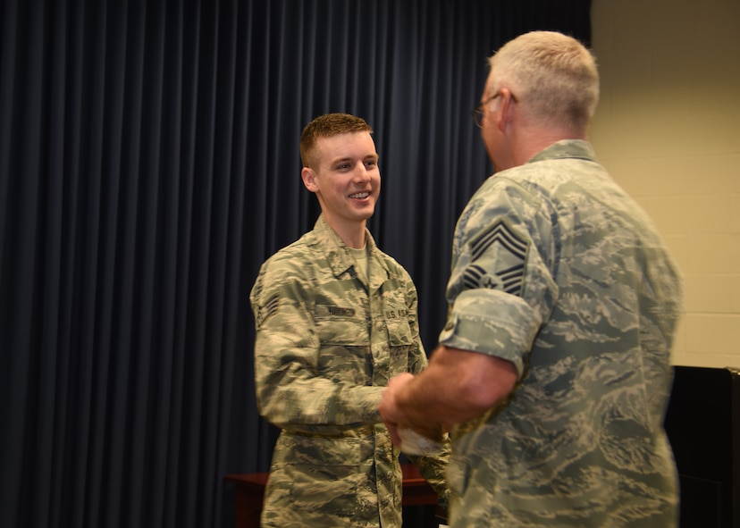 Staff Sgt. Zac Hakinson, 114th Communication Flight information technology specialist, is congratulated by members of the 114th Fighter Wing after receiving his college diploma from Dakota State University April 11, 2017, Joe Foss Field, S.D. Hakinson received his diploma prior to deploying for a Reserve Component Period. (U.S. Air National Guard photo by Staff Sgt. Duane Duimstra/Released)
