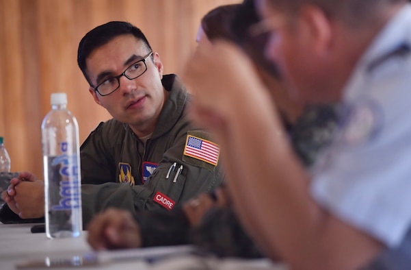 U.S. Air Force Tech. Sgt. Johann Bermudez, U.S. Air Force School of Aerospace Medicine aeromedical evacuation instructor, Wright-Patterson Air Force Base, Ohio, discusses aerospace medicine best practices with members of the Honduran air force as part of a subject matter expert exchange in Tegucigalpa, Honduras, April 4. The global health engagement brought U.S. and Honduran counterparts together to build and strengthen partner relationships.