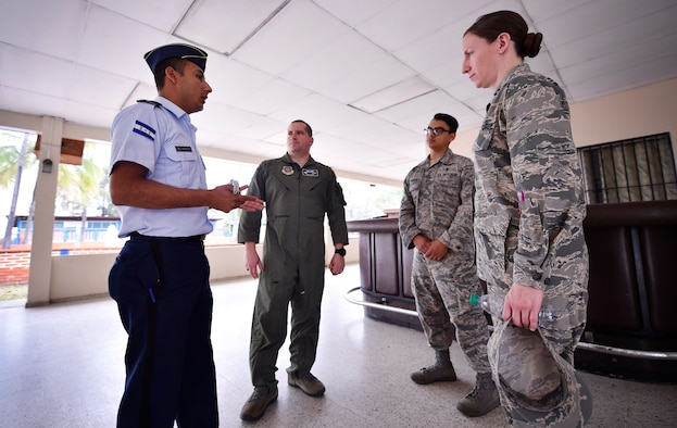Honduran air force Subteniente Auxiliar Sanidad Obed Antonio Contreres Fuentes, left, talks to U.S. Air Force Capt. Diego Torres, center left, Detachment 4, 375th Operations Group flight nurse instructor and evaluator, Wright-Patterson Air Force Base, Ohio, Staff Sgt. Gabriel Trujillo, center right, 779th Medical Operations Squadron paramedic, Joint Base Andrews, Maryland, and Capt. Leslie Whiting, 88th Aerospace Medicine Squadron aerospace nurse manager, Wright-Patterson Air Force Base, Ohio, as part of a subject matter expert exchange in Tegucigalpa, Honduras, April 4. The global health engagement brought U.S. and Honduran counterparts together to build and strengthen partner relationships.
