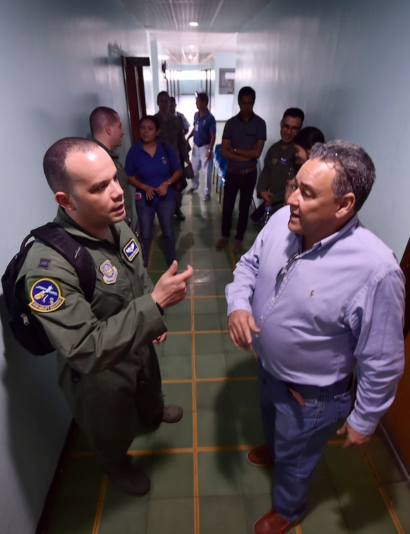 U.S. Air Force Capt. Ricardo Sequeira, 628th Medical Operations Support Squadron and 14th Airlift Squadron flight surgeon, Joint Base Charleston, South Carolina, talks about aerospace medicine best practices with Dr. Jose Alejandro Servellon Duran, Fuerza Aerea de Honduras Comandancia General aerospace medicine, as part of a subject matter expert exchange in Tegucigalpa, Honduras, April 4. The global health engagement brought U.S. and Honduran counterparts together to build and strengthen partner relationships.