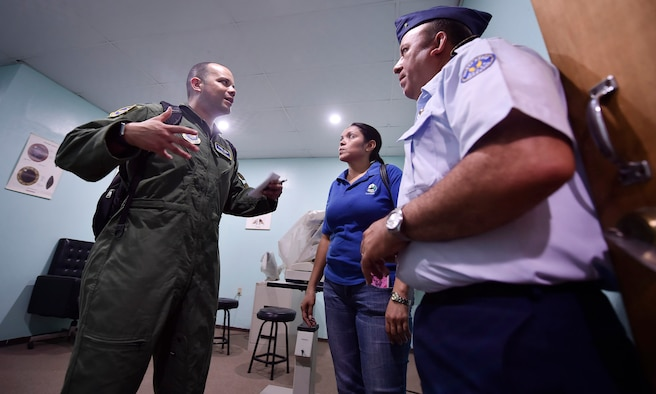 U.S. Air Force Capt. Ricardo Sequeira, 628th Medical Operations Support Squadron and 14th Airlift Squadron flight surgeon, Joint Base Charleston, South Carolina, left, tours a Honduran air force medical clinic as part of a subject matter expert exchange in Tegucigalpa, Honduras, April 4. The global health engagement brought U.S. and Honduran counterparts together to build and strengthen partner relationships.