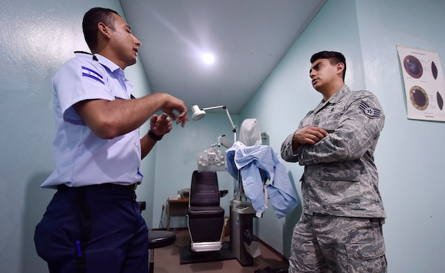 U.S. Air Force Staff Sgt. Gabriel Trujillo, right, 779th Medical Operations Squadron paramedic, Joint Base Andrews, Maryland, right, tours a medical clinic alongside Honduran air force Subteniente Auxiliar Sanidad Obed Antonio Contreres Fuentes, left, as part of a subject matter expert exchange in Tegucigalpa, Honduras, April 4. The global health engagement brought U.S. and Honduran counterparts together to build and strengthen partner relationships.