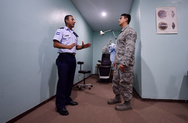 U.S. Air Force Staff Sgt. Gabriel Trujillo, 779th Medical Operations Squadron paramedic, Joint Base Andrews, Maryland, right, tours a medical clinic alongside Honduran air force Subteniente Auxiliar Sanidad Obed Antonio Contreres Fuentes, left, as part of a subject matter expert exchange in Tegucigalpa, Honduras, April 4. The global health engagement brought U.S. and Honduran counterparts together to build and strengthen partner relationships.