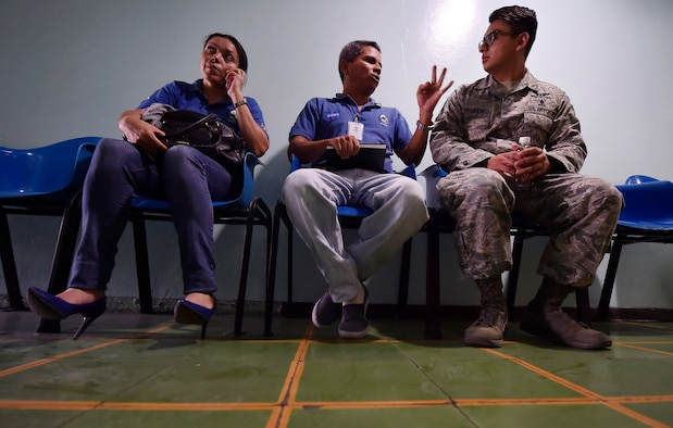 U.S. Air Force Staff Sgt. Gabriel Trujillo, 779th Medical Operations Squadron paramedic, Joint Base Andrews, Maryland, tours a medical clinic alongside Honduran air force members and civilians in the flight medicine field, as part of a subject matter expert exchange in Tegucigalpa, Honduras, April 4. The global health engagement brought U.S. and Honduran counterparts together to build and strengthen partner relationships. (U.S. Air Force photo by Staff Sgt. Christopher Hubenthal)