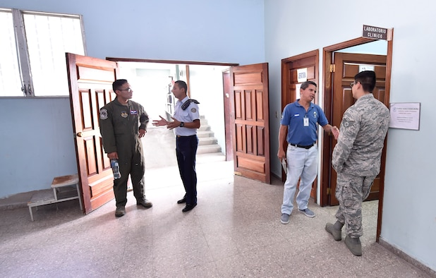 U.S. Air Force Tech. Sgt. Johann Bermudez, U.S. Air Force School of Aerospace Medicine aeromedical evacuation instructor, Wright-Patterson Air Force Base, Ohio, left, and U.S. Air Force Staff Sgt. Gabriel Trujillo, 779th Medical Operations Squadron paramedic, Joint Base Andrews, Maryland, right, tour a Honduran air force medical clinic as part of a subject matter expert exchange in Tegucigalpa, Honduras, April 4. The global health engagement brought U.S. and Honduran counterparts together to build and strengthen partner relationships.