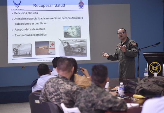 U.S. Air Force Capt. Ricardo Sequeira, 628th Medical Operations Support Squadron and 14th Airlift Squadron flight surgeon, Joint Base Charleston, South Carolina, talks about aerospace medicine with Honduran air force members as part of a subject matter expert exchange in Tegucigalpa, Honduras, April 4. The global health engagement brought U.S. and Honduran counterparts together to build and strengthen partner relationships.