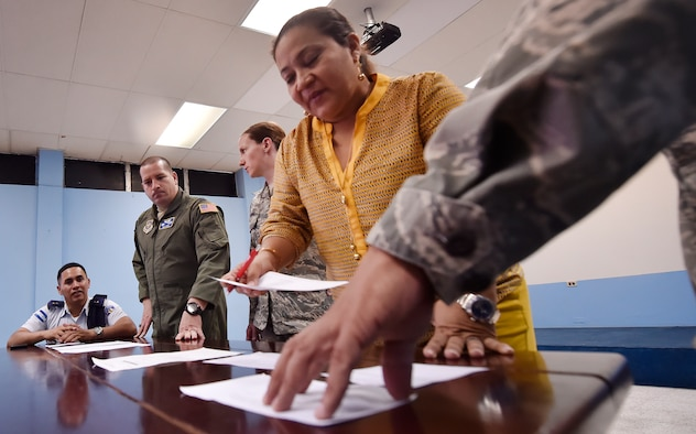 U.S. Air Force and Honduran air force aerospace medicine subject matter experts compare medical administrative forms as part of a subject matter expert knowledge exchange in Tegucigalpa, Honduras, April 5. The global health engagement brought U.S. and Honduran counterparts together to build and strengthen partner relationships.