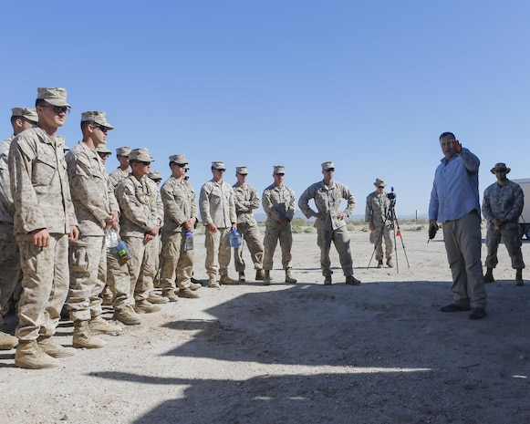 Mr. Brian Long, project officer for the Joint Non-Lethal Weapons Directorate briefs Marines on the Active Denial System during Weapons and Tactics Instructor course (WTI) 2-17 at Site 50, Wellton, Ariz., April 4, 2017. The Aviation Development, Tactics and Evaluation Department and Marine Operational Test and Evaluation Squadron One (VMX-1) Science and Technology Departments conducted the tactical demonstration to explore and expand existing capabilities. MAWTS-1 provides standardized advanced tactical training and certification of unit instructor qualifications to support Marine Aviation Training and Readiness and assist in developing and employing aviation weapons and tactics. (U.S. Marine Corps photo by Lance Cpl. Andrew M. Huff)
