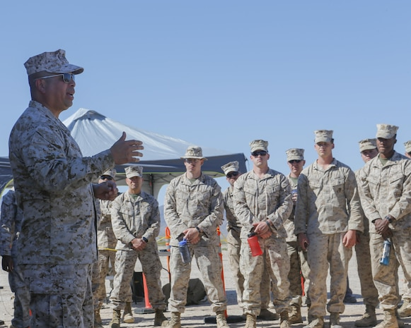U.S. Marine Corps Col. Rey Masinsin, director of the Joint Non-Lethal Weapons Directorate briefs Marines with 2nd Low Altitude Air Defense Battalion, Marine Air Control Group 28, 2nd Marine Air Wing on the Active Denial System during Weapons and Tactics Instructor course (WTI) 2-17 at Site 50, Wellton, Ariz., April 4, 2017. The Aviation Development, Tactics and Evaluation Department and Marine Operational Test and Evaluation Squadron One (VMX-1) Science and Technology Departments conducted the tactical demonstration to explore and expand existing capabilities. MAWTS-1 provides standardized advanced tactical training and certification of unit instructor qualifications to support Marine Aviation Training and Readiness and assist in developing and employing aviation weapons and tactics. (U.S. Marine Corps photo by Lance Cpl. Andrew M. Huff)