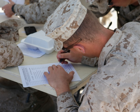 U.S. Marine Corps Cpl. Blake Cannon, a low altitude air defense gunner with 2nd Low Altitude Air Defense Battalion, Marine Air Control Group 28, 2nd Marine Air Wing signs a pre-exposure medical form before volunteering to participate in a tactical demonstration (TACDEMO) of the Active Denial System during Weapons and Tactics Instructor course (WTI) 2-17 at Site 50, Wellton, Ariz., April 4, 2017. The Aviation Development, Tactics and Evaluation Department and Marine Operational Test and Evaluation Squadron One (VMX-1) Science and Technology Departments conducted the TACDEMO to explore and expand existing capabilities. MAWTS-1 provides standardized advanced tactical training and certification of unit instructor qualifications to support Marine Aviation Training and Readiness and assist in developing and employing aviation weapons and tactics. (U.S. Marine Corps photo by Lance Cpl. Andrew M. Huff)