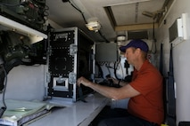 Mr. Paul Pelletier, senior engineer at the Joint Non-Lethal Weapons Directorate controls the Active Denial System (ADS) during Weapons and Tactics Instructor course (WTI) 2-17 at Site 50, Wellton, Ariz., April 4, 2017. The Aviation Development, Tactics and Evaluation Department and Marine Operational Test and Evaluation Squadron One (VMX-1) Science and Technology Departments conducted the tactical demonstration to explore and expand existing capabilities. MAWTS-1 provides standardized advanced tactical training and certification of unit instructor qualifications to support Marine Aviation Training and Readiness and assist in developing and employing aviation weapons and tactics. (U.S. Marine Corps photo by Lance Cpl. Andrew M. Huff)