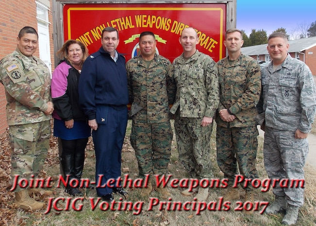 The Joint Non-Lethal Weapons Program's Joint Coordination and Integration Group (JCIG) Voting Principals met to discuss program priorities for the development and funding of NLWs Thursday, Feb. 9, 2017.  The members meet twice a year to review program progress and provide recommendations to the flag level Joint Integrated Product Team. Pictured from left to right: Col. Jesse Galvan, Dr. Shari Sauer, Capt. Jon Totte, Col. Rey Masinsin, Capt. Richard Hayes, Lt. Col. Seth Crawford, and Col. Christopher DeGuelle.