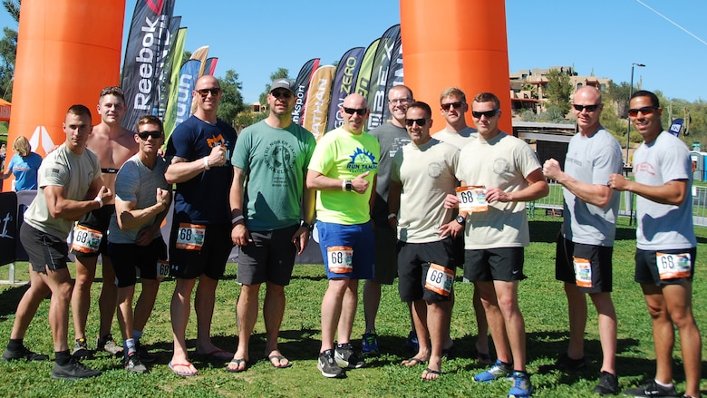 Airmen from the 58th Maintenance Squadron take time to pose for a photo after completing the Ragnar Del Sol relay race in Arizona, March 11. The race went for 200 miles and more than 24 hours.