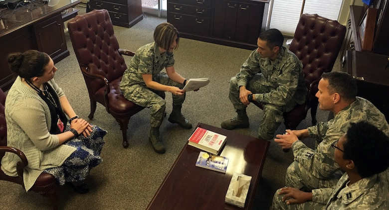 Lt. Col. Jennifer Garrison, 355th Medical Support Squadron Administrator, briefs the members of her Institute of Health Improvement collaboration team on related Plan, Do, Study, Act measures geared toward improving patient access to care at the Davis-Monthan Air Force Base Medical Center, Ariz., April 11, 2017. The 355th Medical Group has increased access to care by 21 percent in primary care manager continuity, which puts the group at 86 percent and on track to meet their 90 percent goal.