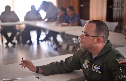 U.S. Air Force Capt. Ricardo Sequeira, 628th Medical Operations Support Squadron and 14th Airlift Squadron flight surgeon from Joint Base Charleston, South Carolina, participates in talks with members of the Honduran air force about flight medicine during an aerospace medicine subject matter expert exchange in Tegucigalpa, Honduras, April 4. The goal of the global health exchange is to share best practices, enhance relationships, and build partnership capacities.