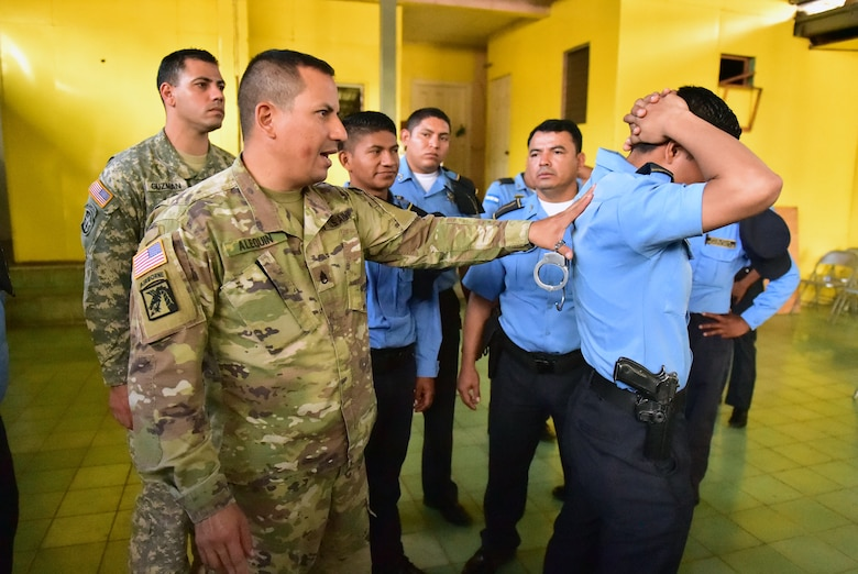 Staff Sgt. José Alequin, Joint Task Force-Bravo Joint Security Forces, shows participants how to properly immobilize a person during a Subject Matter Expert Exchange between JSF and local public forces in Comayagua.