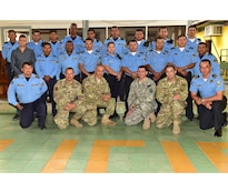 Particpants pose for a photo during a Subject Matter Expert Exchange between Joint Security Forces and local public forces in Comayagua.