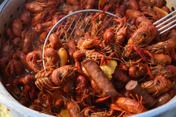 "A pot of boiled crawfish and the 'fixins' soak in seasonings during the 5th Annual Bay Breeze Crawfish Cook-Off at the Bay Breeze Event Center April 7, 2017, on Keesler Air Force Base, Miss. The ""Keesler Chiefs"" won first place overall and a free entry into the 25th Annual Mississippi Coast Coliseum Crawfish Festival Cook-Off. (U.S. Air Force photo by Kemberly Groue)"