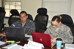 Sergeant Major Mario Ordoñez (left), Honduran Air Force Senior Enlisted Advisor and Master Sgt. Kristen Bamberger (right), JTF-Bravo Command Group Senior Enlisted Advisor, work together during a joint workshop on Soto Cano Air Base, March 23, 2017. The goal of the joint venture is to achieve a higher level of professionalism among local forces, using new teaching techniques that will allow them to pass on knowledge for future generations of soldiers across the Honduran armed forces.