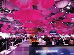 As part of Internet of Things display, booth of Deutsche Telekom at CeBit 2015 shows moving arms of robots holding magenta umbrellas, March 16, 2015 (Courtesy Mummelgrummel)